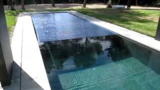Cubierta automatica de lamas de policarbonato, con motor sumergido, cierre, piscina de 13,5 x 3 m