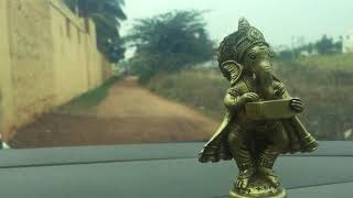 Vinayaka lord statue gadgets as placed in a car travel
