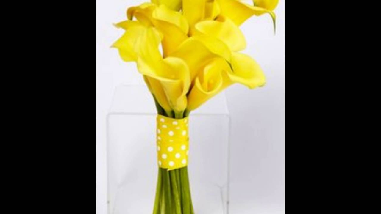 Yellow calla lily and thistle asymetrical centerpiece youtube yellow calla lily and thistle asymetrical centerpiece dhlflorist Images