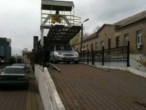 Перевозка автомобиля в автовагоне и выгрузка (Киев)