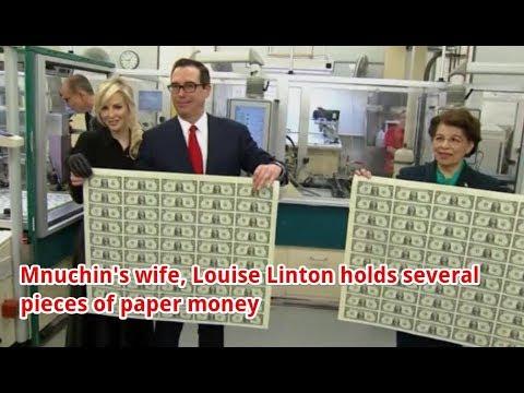 Treasury Secretary Mnuchin's wife Louise Linton holds onto sheets of paper money