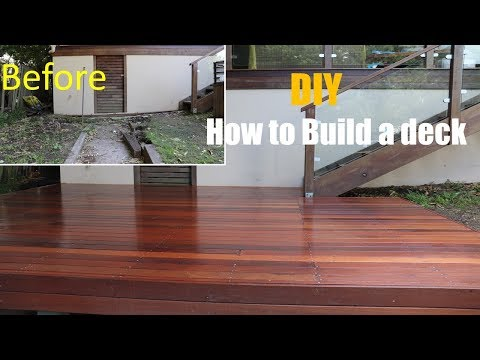 How to build and lay decking on uneven and sloping backyard//Deck DIY// Home improvement