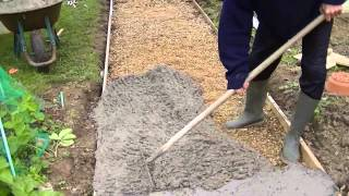 Comment faire une dalle en béton - Coulé une dalle en béton extérieur