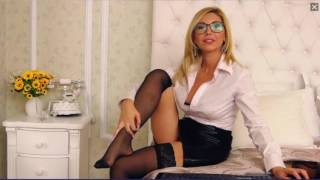 Repeat youtube video Sexy MILF Puts Her Stockings On
