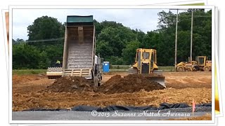 Construction Work With A Bulldozer, Dump Truck And A Road Roller