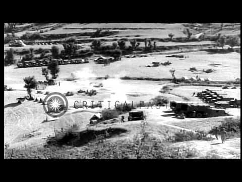 Greek Military soldiers firing at enemy from a machine gun post from the top of a...HD Stock Footage