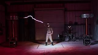 Daft Punk's Derezzed performed with musical Tesla coils.