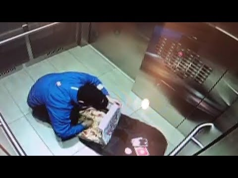 Domino's Pizza delivery driver caught on camera eating pizza toppings