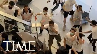 Groups Of Men In White Attack People In Hong Kong's Neighborhood Of Yuen Long | TIME
