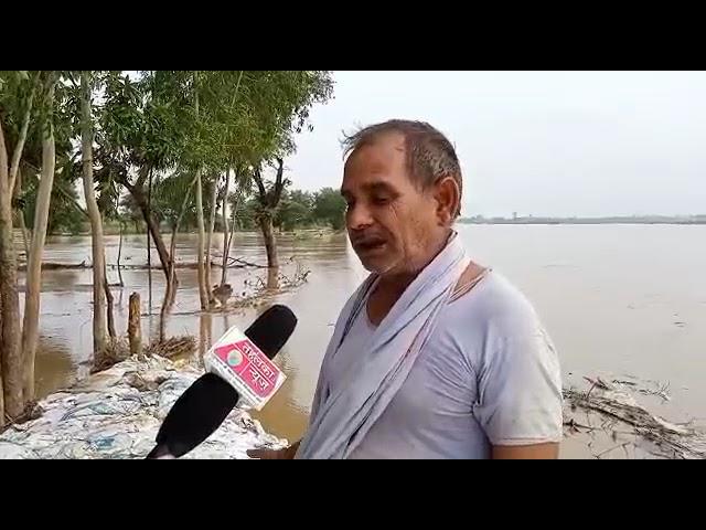 यूपी बलरामपुर जिले में राप्ती नदी तटबंध महरी गांव के पास कट जाने से कई दर्जनों गांव हुए जलमग्न