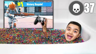 My Little Brother Plays Fortnite In A Bathtub Filled With Orbeez! (FORTNITE ORBEEZ BATH CHALLENGE!)