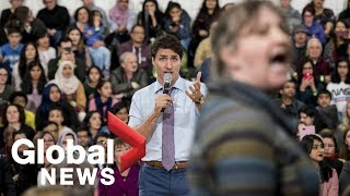 Trudeau gets heated as hecklers interrupt his talk on climate change
