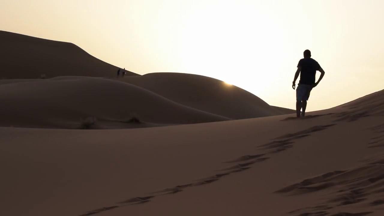 Riding a Camel in SAHARA DESERT