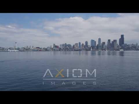 Tilt up from Elliott Bay to reveal Downtown Seattle skyline, Washington | AX45_039