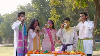 Cheerful Indian teenagers smeared in powder colors celebrating joyful Holi festival