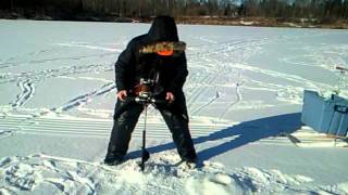 Repeat youtube video Homemade Electric Ice Auger Drilling 8 Holes In a Row Jan.21-2012.