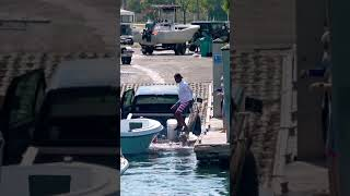 LADY JUMPS IN! BOAT SINKING THEIR TRUCK! #shorts