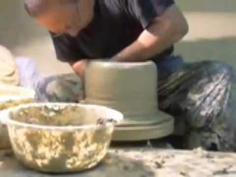 Throwing a large water jar