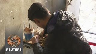 Iraqi artist recreates ancient works destroyed by Islamic State