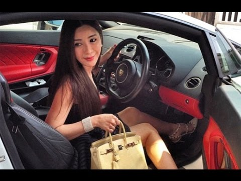 The Rich Kids of Singapore brag about their extreme wealth by lying on beds of cash and driving supe