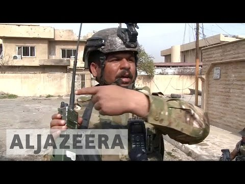 Iraqi troops close on government buildings in west Mosul