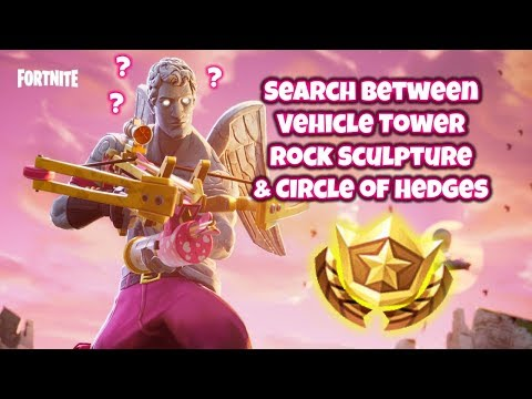 Search Between a Vehicle Tower, Rock Sculpture , and a Circle of Hedges Fortnite Gameplay