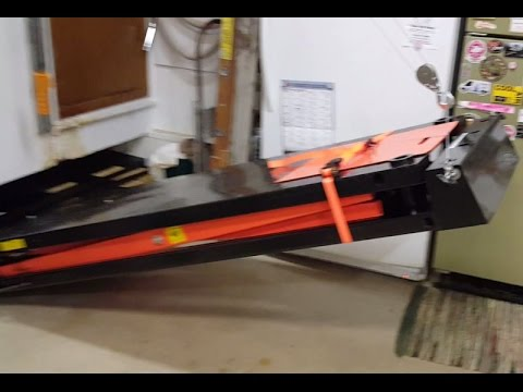 Hoisting Motorcycle Lift Table Against Wall Via Electric