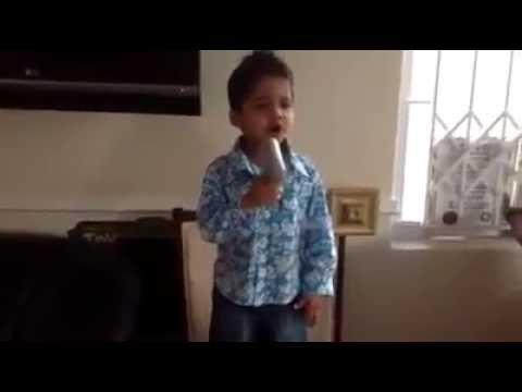 indian kid singing wahamba nathi by Solly Mahlangu