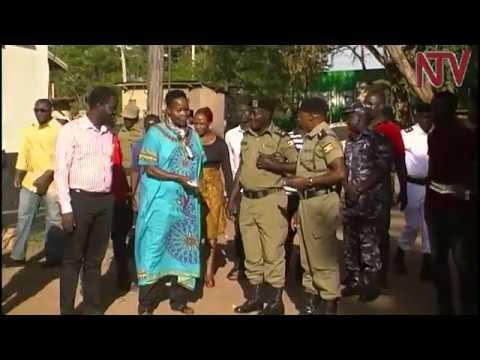Pastor Imelda Namutebi prays for police officers and prisoners at Busia central police station