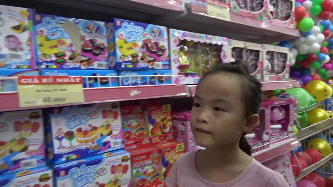 Baby cute with fun family goes shopping and color toys for kids