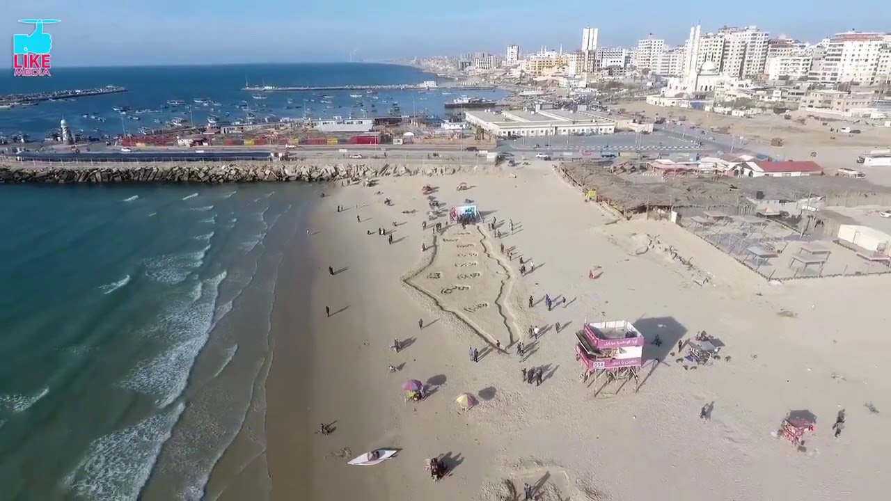 Tropical Island Beach Ambience Sound: بأكبر خريطة لفلسطين على شاطئ بحر غزة.. حلم الشهيد محمد