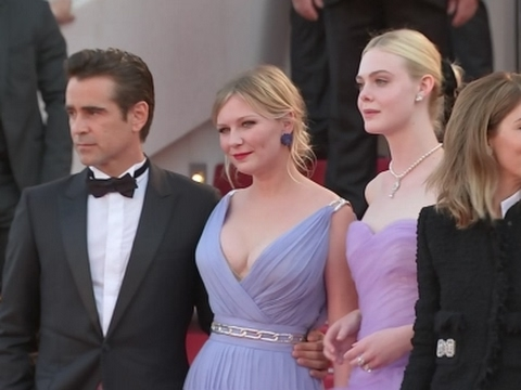 Kirsten Dunst wows crowds; wipes away tears on Cannes red carpet