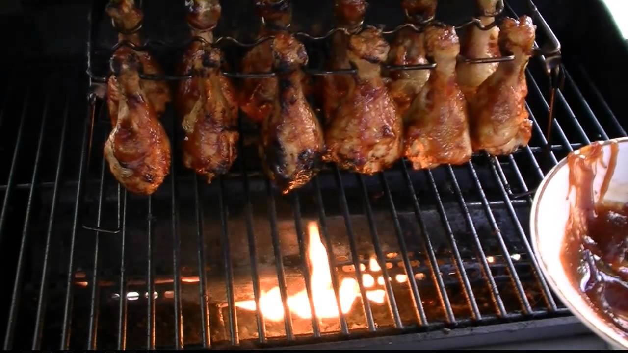 grilled bbq chicken legs or wings rack on a propane grill