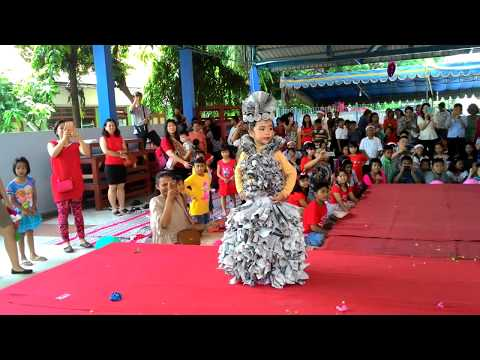 Fashion show. Newspaper dress. Artis Kinsey Vania Indarta