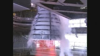 NASA test fires engine for world's most powerful rocket