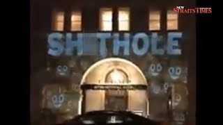 'Sh*thole' projected on Trump's hotel in Washington