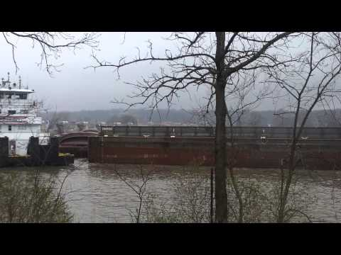 Barges get stuck in a dam