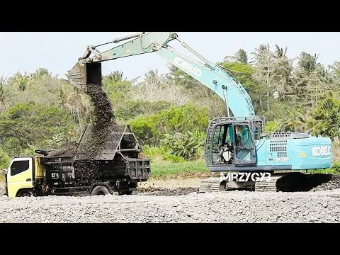 Excavator Loading Sand And Dirt Into Dump Truck Kobelco SK200-10