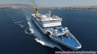 Aerial (drone) video - Blue Galaxy leaving Piraeus port