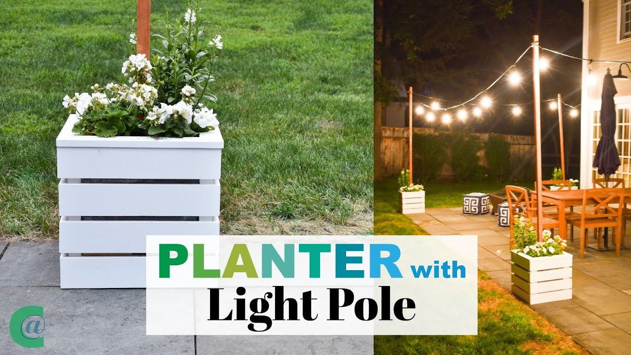 wooden planters with pole for string lights