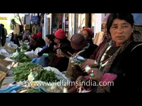 Ladakhi women in full regalia selling organic vegetables