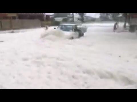 Cyclone Debbie sea foam covers road