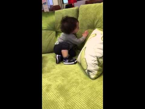 Zubi trying sofa at DFS