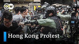 Hong Kong: Thousands defy lockdown orders to protest China's security law | DW News