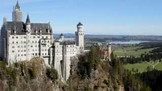 neuschwanstein castle | German travel guide | neuschwanstein castle video guide(Neuschwanstein Castle is a nineteenth-century Romanesque Revival palace on a rugged hill above the village of Hohenschwangau near Füssen in southwest ..., 2015-04-02T16:04:52.000Z)