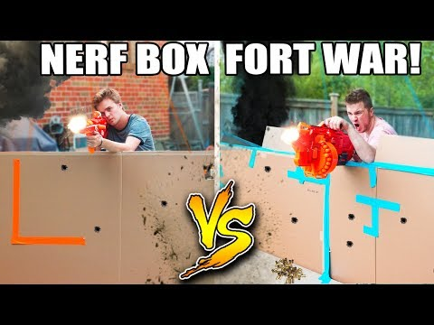 WORLDS BIGGEST BOX FORT NERF WAR! 1v1 NERF BATTLE!