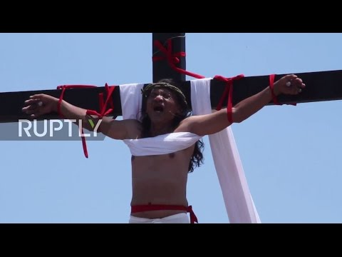 Philippines: Devotees reenact Christ's crucifixion on Good Friday *GRAPHIC*