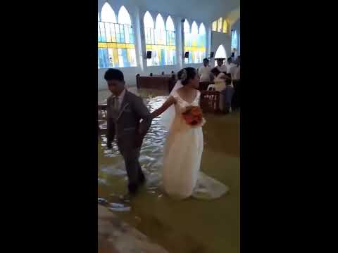 Jordan - Couple Marries In A Flooded Church!