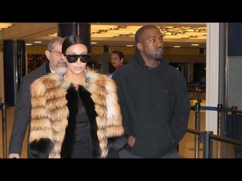Kim Kardashian Is Elegant In Fur Passing Through JFK