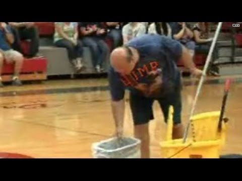 School surprises janitor with $$